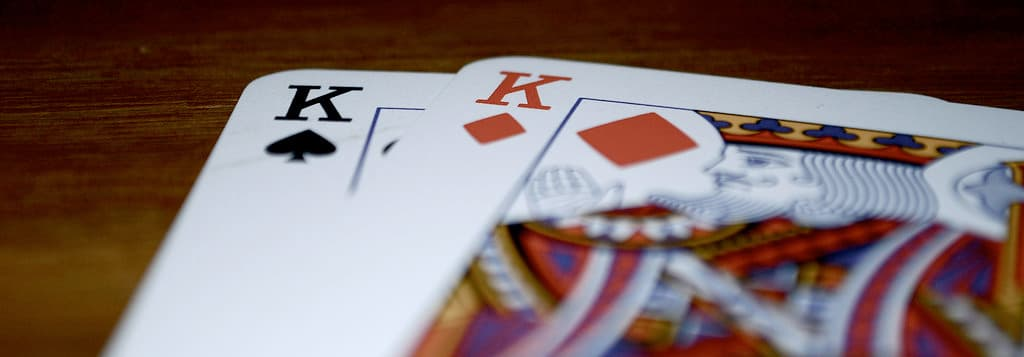 Close up of playing cards showing the king of spades and king of diamonds